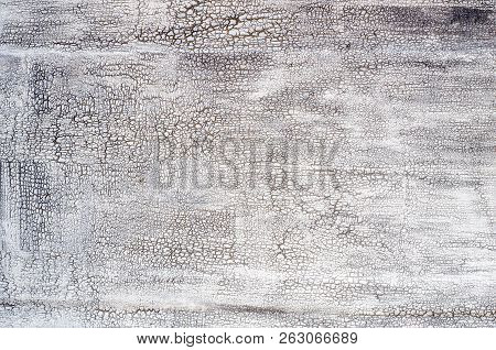 Grey Texture With Crackles.ancient Wooden Background With Pale Silver Peeling Paint. The Old Wooden