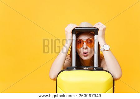 Fun Traveler Tourist Woman In Summer Casual Clothes Hat Look Through Suitcase Isolated On Yellow Ora
