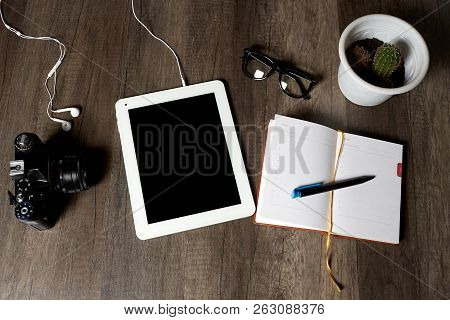 Vintage Camera, Digital Tablet With Headphones, Diary With A Pen For Notes, Glasses And Cactus Lie O