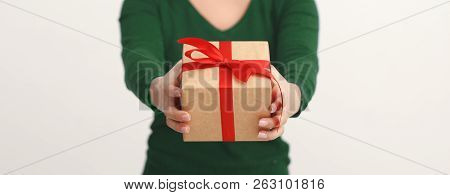 Unrecognizable Excited Woman Holding Gift, Giving Box To Camera Over White Background. Holiday Celeb