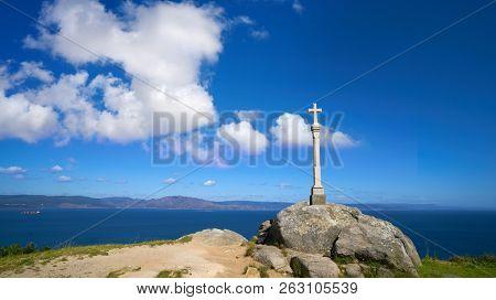 Cross in finisterre end of Saint James Way in Spain Camino de Santiago