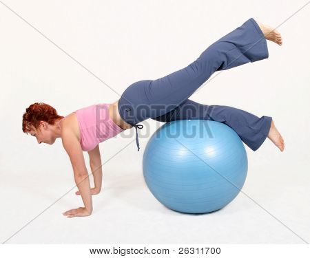 A woman with gym ball