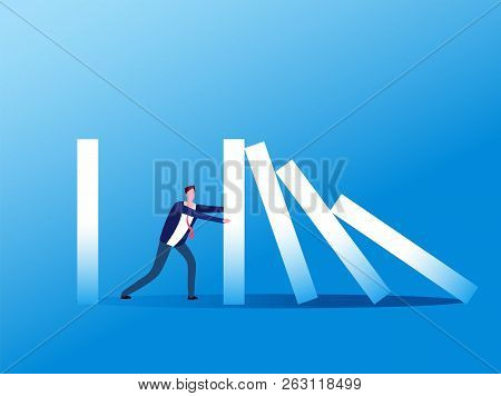 Domino Effect. Businessman Stopping Falling Domino. Crisis Management, Finance Intervention And Conf