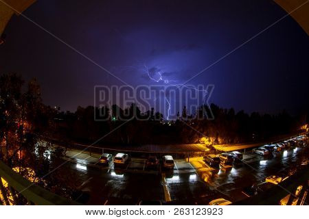 Lightening storm in Southern California as seen from the patio of a third floor apartment.