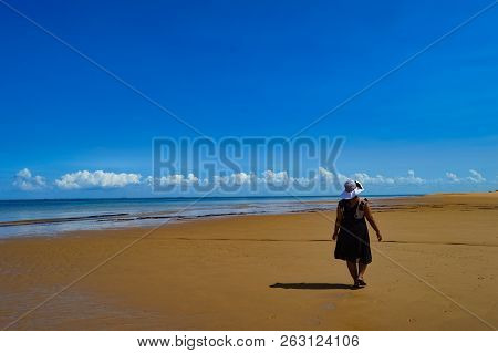 A Young Indian Girl/lady Taking A Walk In Beautiful Portuguese Island Beach With Turqoise Water , Mo