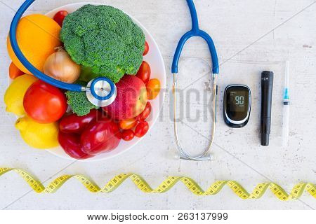 Diabetes Healthy Diet Concept, Raw Vegetables And Fruits With Blood Glucose Meter And Insulin Syring