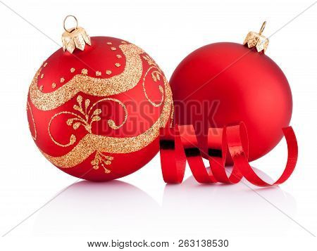 Two Red Christmas Decoration Baubles And Curling Paper Isolated On White Background