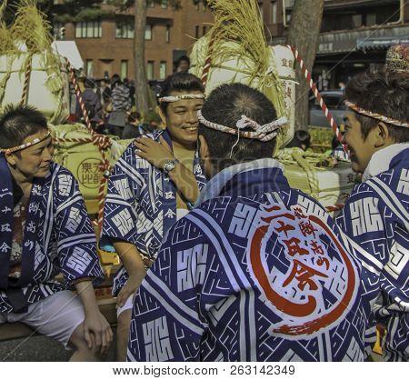Kyoto, Japan - 2010: Participants At Sake Festival Taking A Break