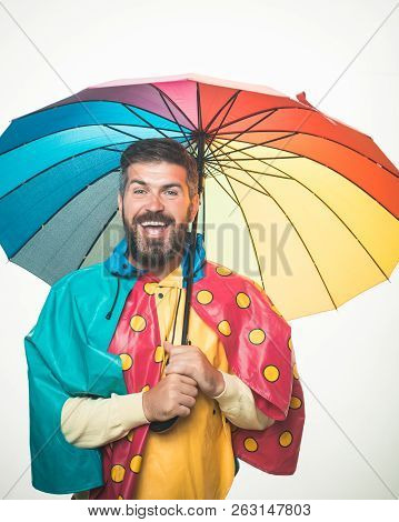 Autumn Mood And The Weather Are Warm And Sunny And Rain Is Possible. Brutal Bearded Man With Rainbow