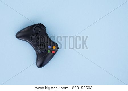 Black Joystick Is Isolated On A Pastel Blue Background. Video Game. Gaming Concept. Copyspace. Flayl