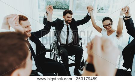 Collective Work. Group Disabled Worker. Workers With Disabilities. Business Meeting. Business Suits.