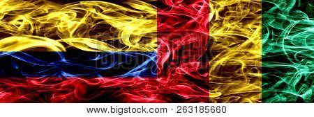 Colombia Vs Guinea, Guinean Smoke Flags Placed Side By Side. Thick Colored Silky Smoke Flags Of Colo