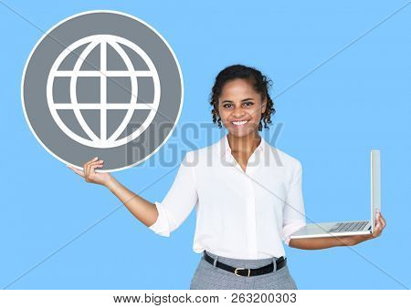 Happy woman holding a laptop and www icon