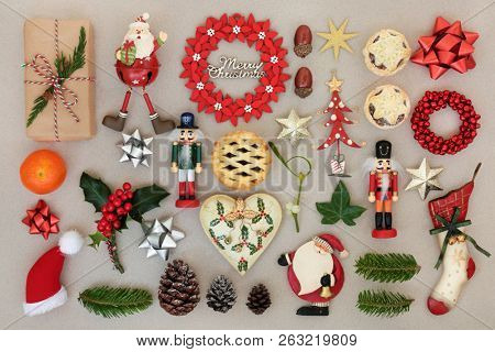 Christmas decorations with food, flora, bows and traditional symbols forming an abstract background. Festive Christmas card for the holiday season. Top view.