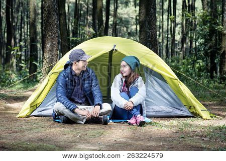 Portrait Of Asian Couple Sitting And Talking On The Camping Tent