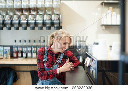 Funny Laughing American Trendy Caucasian Girl Laughing Sitting In Coffehouse