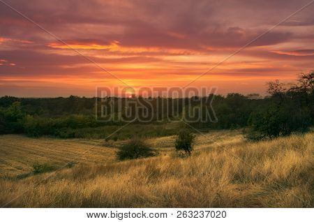 Sunset In Countryside Landscape. Fields And Countryside Landscape. Nature Landscape. Sunset In Field