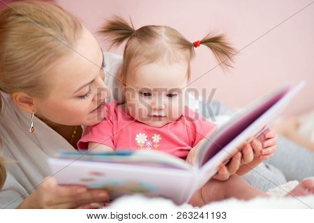 Mommy Reads Her Baby Daughter A Book