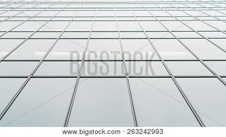 Wide-angle View From The Bottom Of Glass Facade Of A Modern Office Skyscraper; A Business High-rise