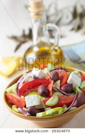 Greek salad with feta cheese and calamata olives in a bowl poster