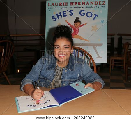 HUNTINGTON, NY - OCT 11: Olympian Laurie Hernandez signs copies of her book