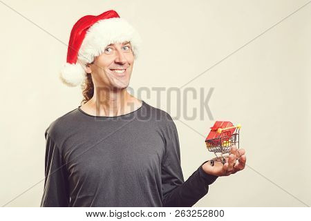 Christmas Sales Concept. Happy Christmas Man Holding Small Shopping Cart With Christmas Gift, Isolat