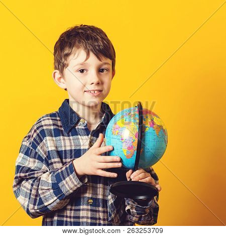 Curious Boy Holding Earth Globe Map. Little Traveler, Isolated On Yellow. Kid Exploring The New Hori