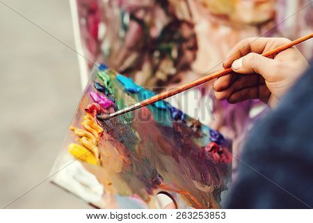 Artist Brush Mixed Color Oil Painting On Palette. Macro Artist's Palette. Palette With Paintbrush. A