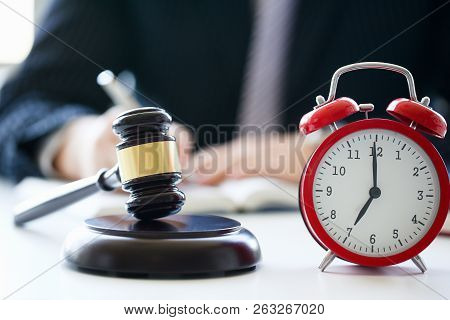 Red Alarm Slock And Judge Hammer Lies On Table In Debate Room For Fair Judgments Economic Notions Of