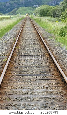 Rural Railway Line Tracks In Countryside At Talsarnau, Gwynedd In North Wales Uk.