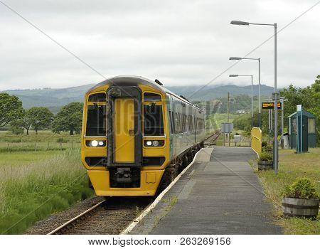 Railway Diesel Train Locomotive At Rural Talsarnau Station, Gwynedd In North Wales Uk.