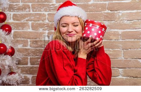 Excited About Present. Girl Dress Near Christmas Tree. Unpacking Christmas Gift. Woman In Santa Hat