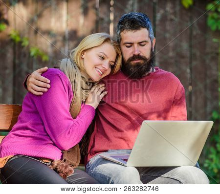 Couple In Love Notebook Consume Content. Couple With Laptop Sit Bench In Park Nature Background. Sur