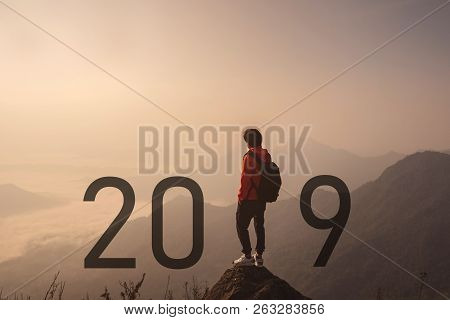 Young Traveler Standing And Looking At Beautiful Landscape On Top Of Mountain, New Year 2019 Celebra