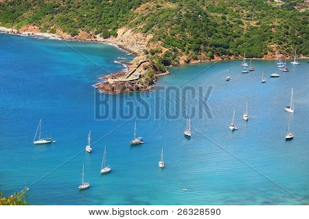 A view of English Harbour and Fort Berkeley on the coast of the island of Antigua in the Caribbean.