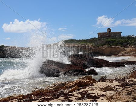 Waves Crashing Into Rocks And Beach Surrounding The Lighthouse Of Puerto Ferro On Vieques Puerto Ric