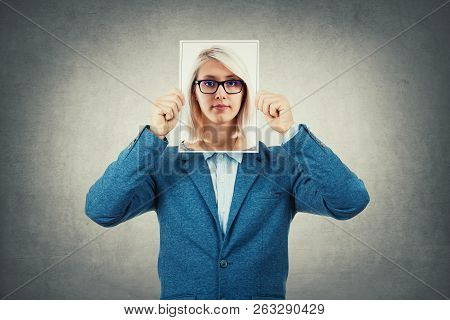 Businessman Use A Woman Portrait As Undercover, Hiding His Face Behind Photo Sheet, Like A Fake Mask