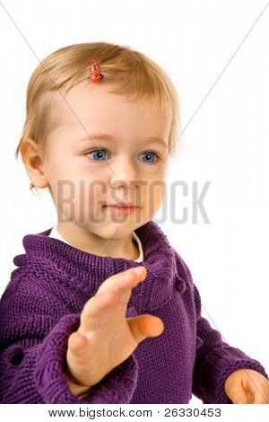 Portrait of cute baby girl giving a five or reaching for sth.