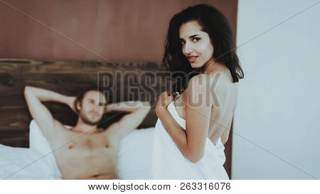 Brunette Girl. Naked Sexy Girl In White Towel. Woman On Bed. White Linens. Man Topless. Woman In Red