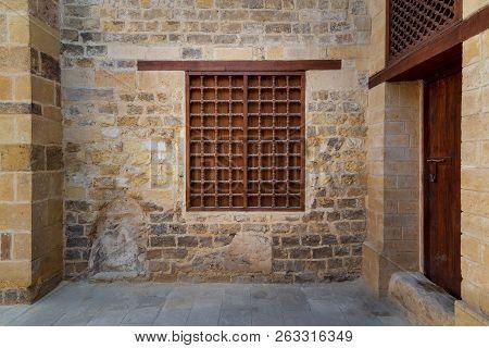 Mamluk Era Wooden Closed Window With Wooden Ornate Grid Over Stone Bricks Wall, Tekkeyet Al Bustami,