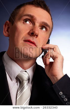 Portrait of business man or politician with  mobile phone