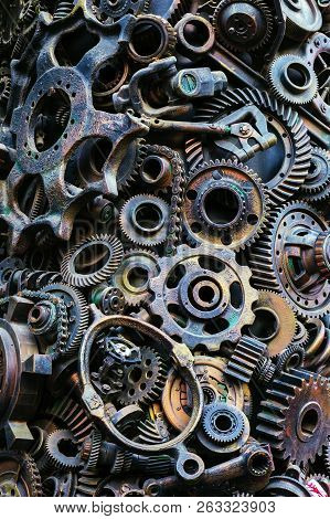 Steampunk Background, Machine Parts, Large Gears And Chains From Machines And Tractors. Old Rusty Ma