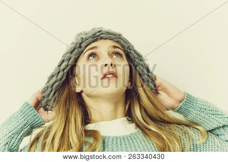 Pretty Girl Or Cute Young Woman With Blond Hair And Adorable Face In Fashionable Blue Sweater And Ha