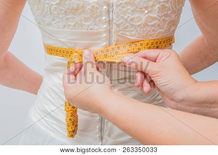 Bride Who Tries The Dress With The Seamstress