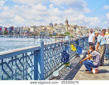 Citizens Fishing On The Galata Bridge. Istanbul, Turkey.