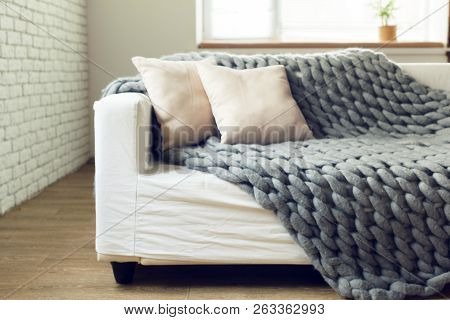 Grey Knit Giant Plaid With Pillows. Object. Macro Photography. Close Up