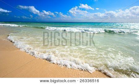 Beautiful beach and  waves of Caribbean Sea