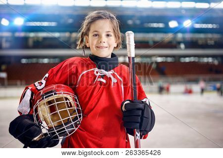 young girl hockey players in ice