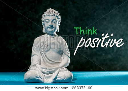 Think Positive. Positive Thinking - Motivating And Inspiring Concept With Meditating Little Buddha.