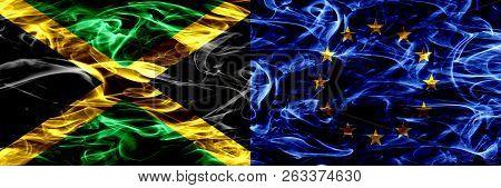 Jamaica Vs European Union, Eu Smoke Flags Placed Side By Side. Thick Colored Silky Smoke Flags Of Ja